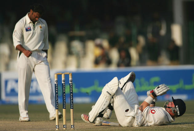 LAHORE, PAKISTAN - DECEMBER 2:  Ian Bell of England gets knocked to the ground after being hit by a Shoaib Akhtar delivery during the fourth Day of the Third and Final Test Match between Pakistan and