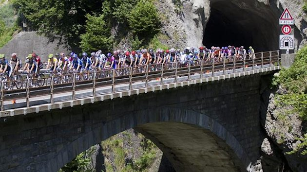 The pack of riders crosses a bridge on the way up to Soerenberg during the 9th stage, a 216 km race from Naefels-Lintharena to Soerenberg, at the 76th Tour de Suisse cycling race, Switzerland, Sunday, June 17, 2012.