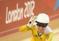 Australia's Kaarle Mcculloch celebrates after winning the Women's team sprint bronze on August 2. Three spectators were thrown out of the Olympic Velodrome, London police said, after a stream of verbal abuse was directed her family