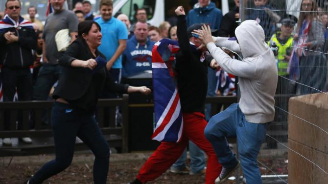 A pro-independence protestor tussles with pro-union protestors during a demonstration at George Square in Glasgow