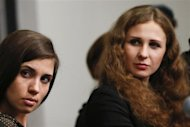 Nadezhda Tolokonnikova (L) and Maria Alyokhina, members of Russian punk rock band Pussy Riot, listens during a news conference before the Amnesty International Bringing Human Rights Home concert in New York February 5, 2014. REUTERS/Shannon Stapleton