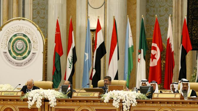 Egyptian President Mohammed Morsi, center, attends the third session of the Arab Economic Summit, in Riyadh, Saudi Arabia, Monday, Jan. 21, 2013. Saudi Arabia is hosting the Arab Economic Summit on January 21 and 22. (AP Photo)