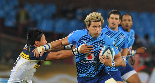 South African Northern Bulls's Wynand Olivier (R) avoids a tackle from Australian Brumbies's flyhalf Christian Lealiifano during the Super 15 Rugby Match between Bulls and Brumbies at Loftus Versfeld