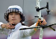 South Korea's Ki Bo-Bae competes against US' Khatuna Lorig in the women's archery semifinal match at Lord's Cricket Ground in London during the London 2012 Olympic Games. Ki Bo-Bae added the Olympic Games women's individual archery gold to her team title victory when she defeated Mexico's Aida Roman in the final at Lord's