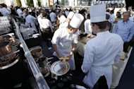 Chefs serve people at a local producers&#39; market on November 17. Boasting a combined 300 Michelin stars among them, 240 chefs convened in the waterside Sporting Monte Carlo complex -- where 14 of them set to work for lunch
