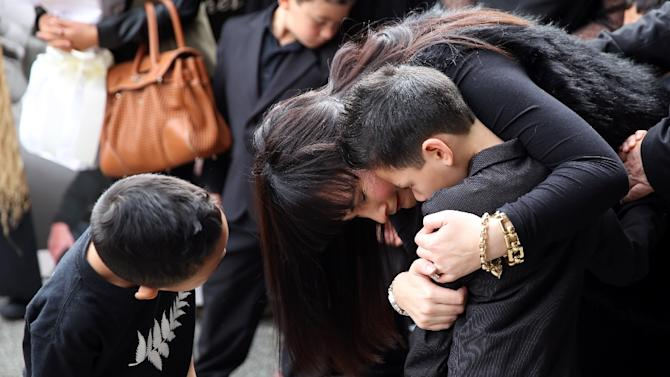 Widow of Jonah Lomu, Nadene Lomu and her two sons, Brayley Lomu (R) and Dhyreille Lomu (L), said their last goodbyes at the funeral for Jonah Lomu on December 01, 2015 in Auckland, New Zealand