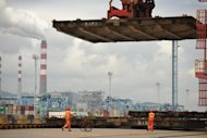 <p>Workers prepare to load a container ship in the Ningbo Port, on June 21. China's manufacturing activity fell to a seven-month low in June, according to official figures, despite government efforts to arrest a slowdown in the world's second largest economy.</p>