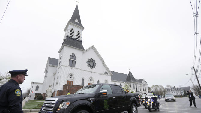 A truck that belonged to fallen Massachusetts Institute of Technology police officer Sean Collier is part of a funeral procession as it departs St. Patrick's Church in Stoneham, Mass., following a funeral Mass for Collier, Tuesday, April 23, 2013. Collier was fatally shot on the MIT campus Thursday, April 18, 2013. Authorities allege that the Boston Marathon bombing suspects were responsible. (AP Photo/Steven Senne)