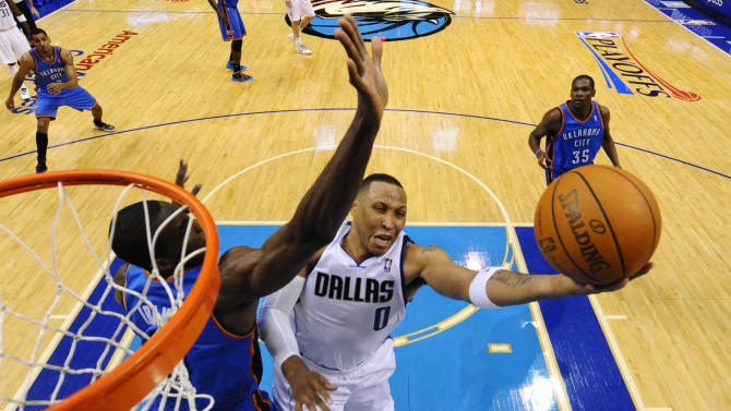 Dallas Mavericks' Shawn Marion (0) goes up for a shot as Oklahoma City Thunder's Serge Ibaka (9) of Congo defends in the second half of Game 3 in the first round of the NBA basketball playoffs Thursday, May 3, 2012, in Dallas.  The Thunder won 95-79. (AP Photo/Larry W. Smith, POOL)