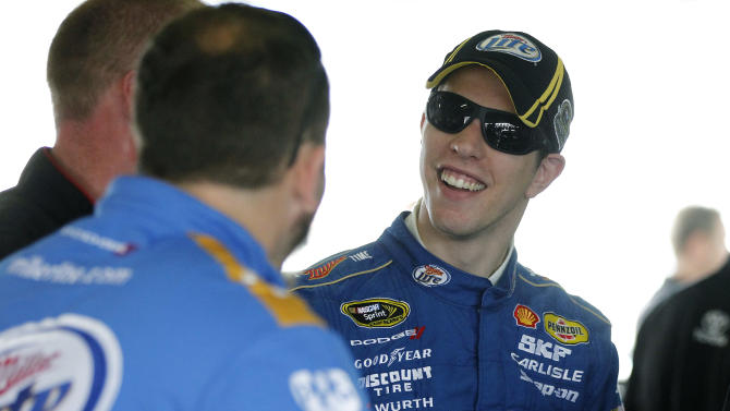 Driver Brad Keselowski talks to his crew during the practice session for Sunday's NASCAR Sprint Cup Series auto race, Sunday, at the Homestead-Miami Speedway in Homestead, Fla., Friday, Nov. 16, 2012. (AP Photo/Terry Renna)
