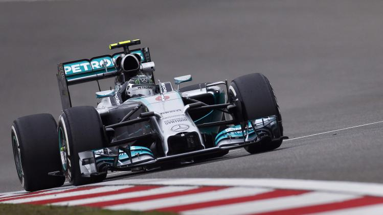Mercedes Formula One driver Nico Rosberg of Germany drives during the first practice session of the Chinese F1 Grand Prix at the Shanghai International circuit