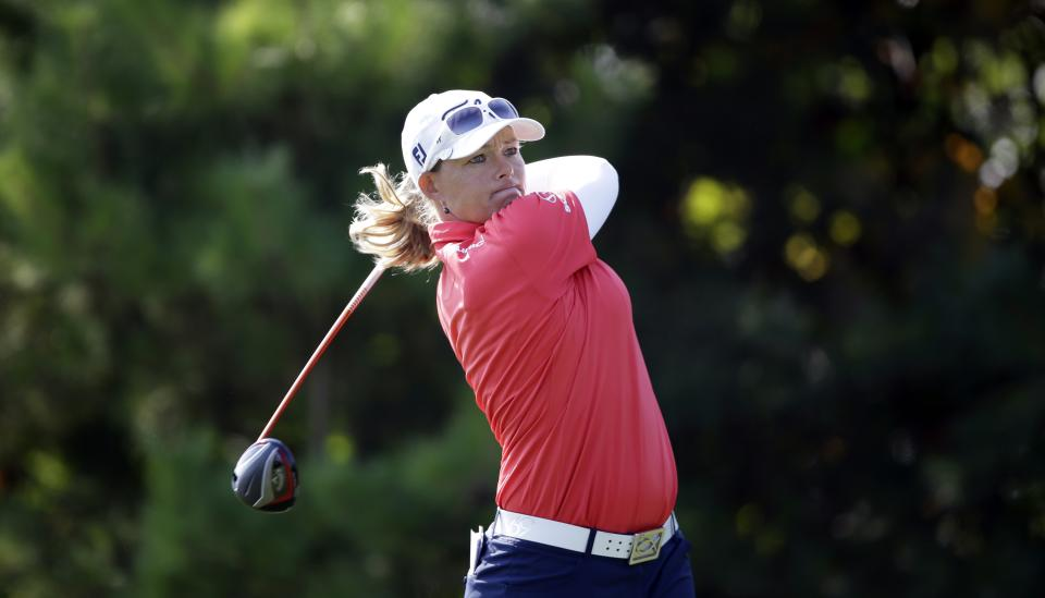 Katherine Hull-Kirk of Australia watches her shot on the fourth hole during the final round of the KEB Hana Bank Championship golf tournament at Sky72 Golf Club in Incheon, west of Seoul, South Korea, Sunday, Oct. 20, 2013. (AP Photo/Lee Jin-man)
