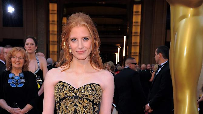 Jessica Chastain arrives before the 84th Academy Awards on Sunday, Feb. 26, 2012, in the Hollywood section of Los Angeles. (AP Photo/Chris Pizzello)