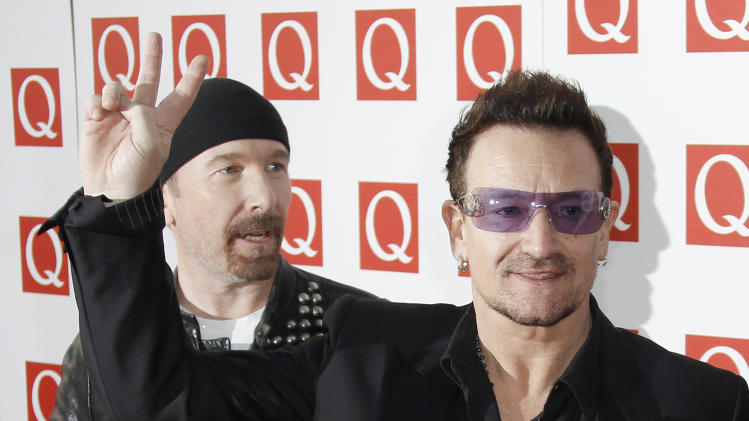 Members of the Irish Band U2, Bono, right, and The Edge, arrive on the red carpet for the Q Music Magazine Awards at a central London hotel, Monday, Oct. 24, 2011. (AP Photo/Joel Ryan)