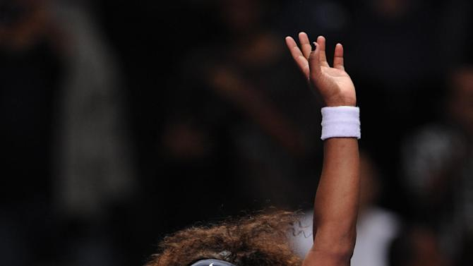 Serena Williams of the US waves to spectators after her tennis match against Victoria Azarenka of Belarus during their tennis match on the third day of the WTA championship in Istanbul, Turkey, Thursday, Oct. 25, 2012. (AP Photo)