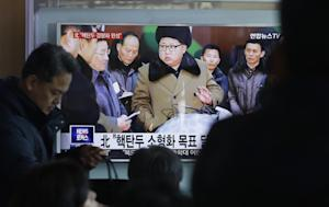 People watch a TV news program showing North Korean …