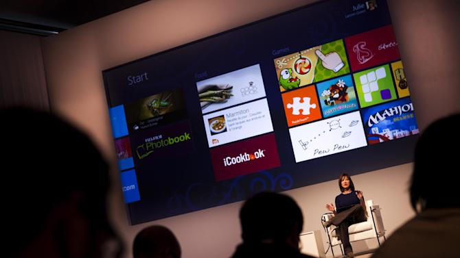 Corporate Vice President of Windows Program Management, Julie Larson-Green attends the Windows 8 Consumer Preview presentation during a press conference at the Mobile World Congress in Barcelona, Spain, Wednesday, Feb. 29, 2012. A test, or beta, version of the revamped operating system has been unveiled Wednesday in Barcelona, nudging it a step closer to its anticipated release next fall. (AP Photo/Emilio Morenatti)