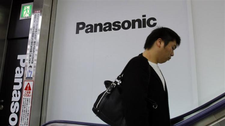 Man walks past Panasonic Corp's logos at an electronics store in Tokyo