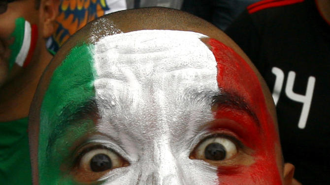 A fan of Mexico's soccer team with his face painted the colors of his nation's flag celebrates his team's 2-1 victory over Brazil and winning of the gold medal for men's soccer at the London 2012 Summer Olympics, in Mexico City, Saturday, Aug. 11, 2012. (AP Photo/Marco Ugarte)