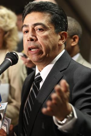 Chicago Alderman Danny Solis speaks during a news conference Wednesday, Nov. 2, 2011, in Chicago, before introducing an ordinance to the City Council that would turn possession of a small amount of marijuana from a misdemeanor into an infraction that is no more serious than a traffic citation. Solis says his ordinance that would require people caught with 10 grams or less of marijuana to pay a $200 fine would mean about $7 million a year in revenue for the city. (AP Photo/M. Spencer Green)