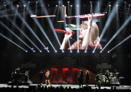 FILE - This Dec. 1, 2012 file photo shows Taylor Swift performing underneath a video monitor during the KIIS FM's Jingle Ball at Nokia Theatre LA Live in Los Angeles. Swift is one of many artists performing at the Grammy Nominations concert airing Wednesday, Dec. 5, at 10 p.m. EST on CBS. (Photo by Chris Pizzello/Invision/AP, file)