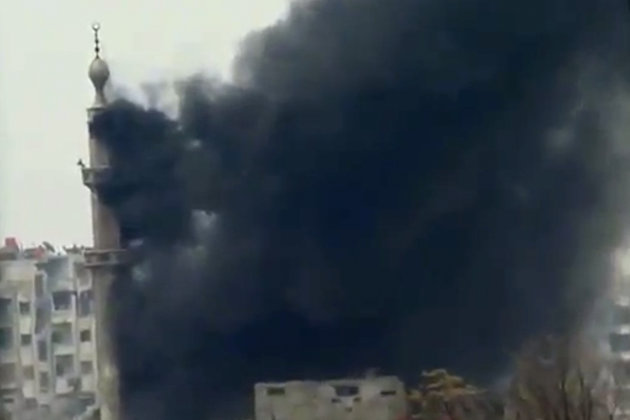 This image taken from video obtained from Ugarit News, which has been authenticated based on its contents and other AP reporting, shows smoke and fire billowing from an explosion in Damascus, Syria, W