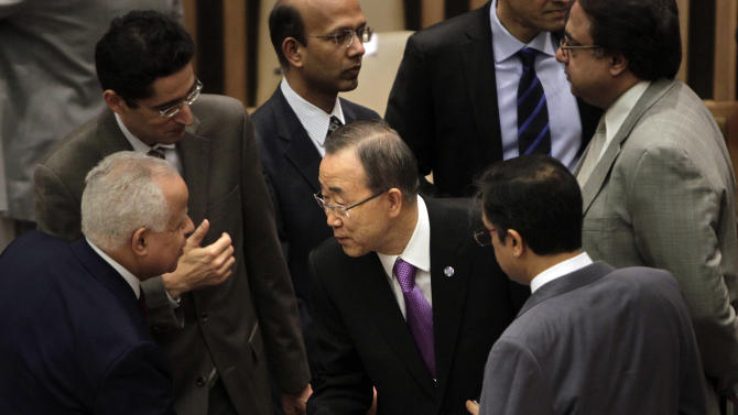 United Nations Secretary-General Ban Ki-moon, center, greets diplomats before the start of a Security Council meeting at United Nations Headquarters, Monday, March 12, 2012.  (AP Photo/Seth Wenig)