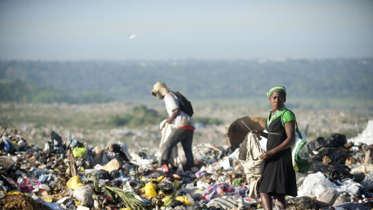 A woman collects recyclable material in the Duquesa garbage dump in Santo Domingo