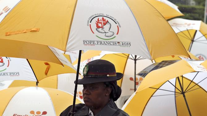 A police woman stands in front of the altar before the mass by Pope Francis in Kenya's capital Nairobi