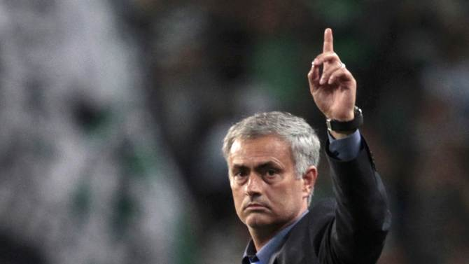 Chelsea's coach Mourinho gestures after their Champions League Group G soccer match against Sporting Lisbon at the Estadio Jose Alvade in Lisbon