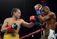CARSON, CA - JULY 07:  Jeffery Mathebula of South Africa takes a punch from Nonito Donaire of The Phillipines during the fourth round of the WBO IBF Super Bantamweight title fight at The Home Depot Center on July 7, 2012 in Carson, California.  Donaire would win in a unanimous decision.  (Photo by Harry How/Getty Images)
