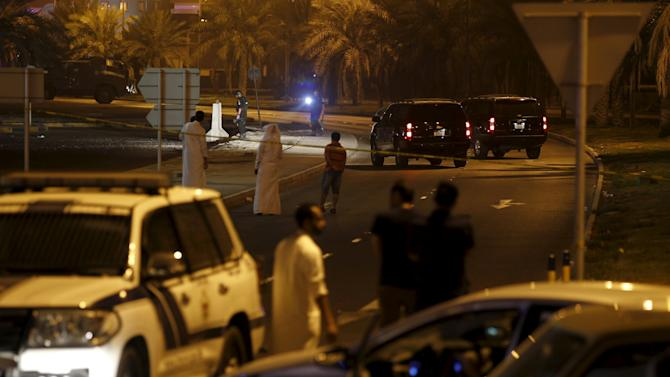 Policemen and EOD officials are seen at the bomb blast site where one police officer was killed late Friday evening in Budaiya west of Manama