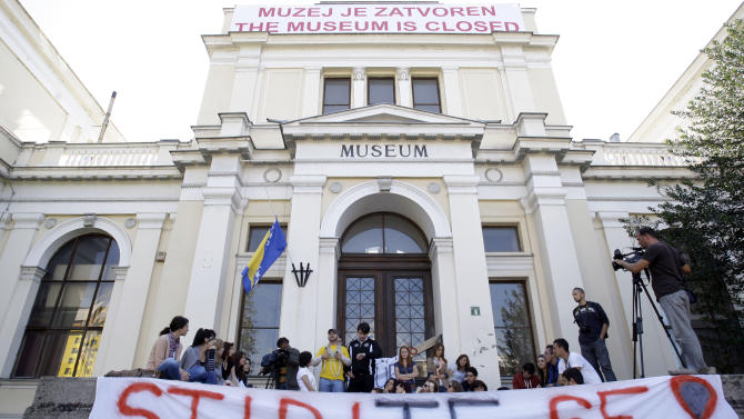 """Group of students shout slogans with banner reading """"Shame on you"""" in front  of National Museum,  in Sarajevo, Bosnia, on Thursday, Oct. 4, 2012.  Bosnia's 124 years-old National Museum closed its doors Thursday following disputes among politicians and dwindling state funding, with employees not receiving their salaries for a year.(AP Photo/Amel Emric)"""