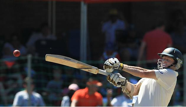 Australia's batsman Chris Rogers, plays a shot on the fourth day of their 2nd cricket test match against South Africa at St George's Park in Port Elizabeth, South Africa, Sunday, Feb. 23, 2014