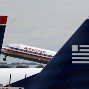 American, US Airways close merger