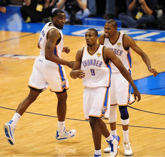 Oklahoma City Thunder's Kendrick Perkins (L), Serge Ibaka (C) And Kevin Durant (R) React To A Basket  In Game 1 Of The AFP/Getty Images