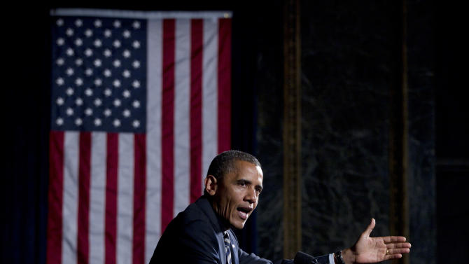 President Barack Obama gestures as he speaks at a campaign event at Chicago Cultural Center, Friday, June 1, 2012, in Chicago. (AP Photo/Carolyn Kaster)