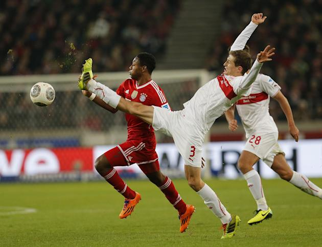 Stuttgart's Daniel Schwaab, right, and Bayern's David Alaba of Austria challenge for the ball during a German first soccer division Bundesliga match between VfB Stuttgart and FC Bayern Munich