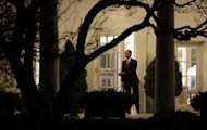 US President Barack Obama leaves the White House after delivering a statement late January 1, 2013 in Washington DC. Obama has signed into law the contentious compromise bill hammered out in Congress, narrowly averting the US 'fiscal cliff' of tax hikes and drastic, immediate cuts in spending, the White House said early Thursday