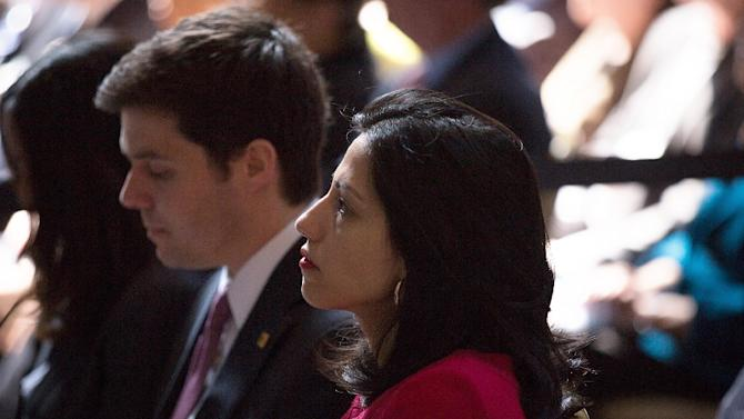 Aide Huma Abedin watches as democratic presidential hopeful and former Secretary of State Hillary Clinton speaks at Columbia University on April 29, 2015 in New York City