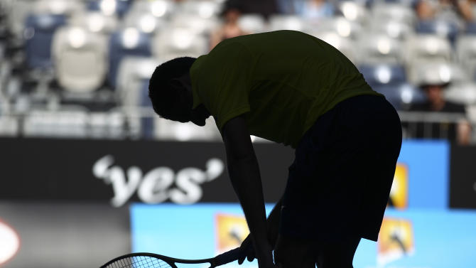 Nicolas Almagro of Spain reacts after losing a point to Tomas Berdych of the Czech Republic  in their fourth round match at the Australian Open tennis championship in Melbourne, Australia, Sunday, Jan. 22, 2012. (AP Photo/Rick Rycroft)