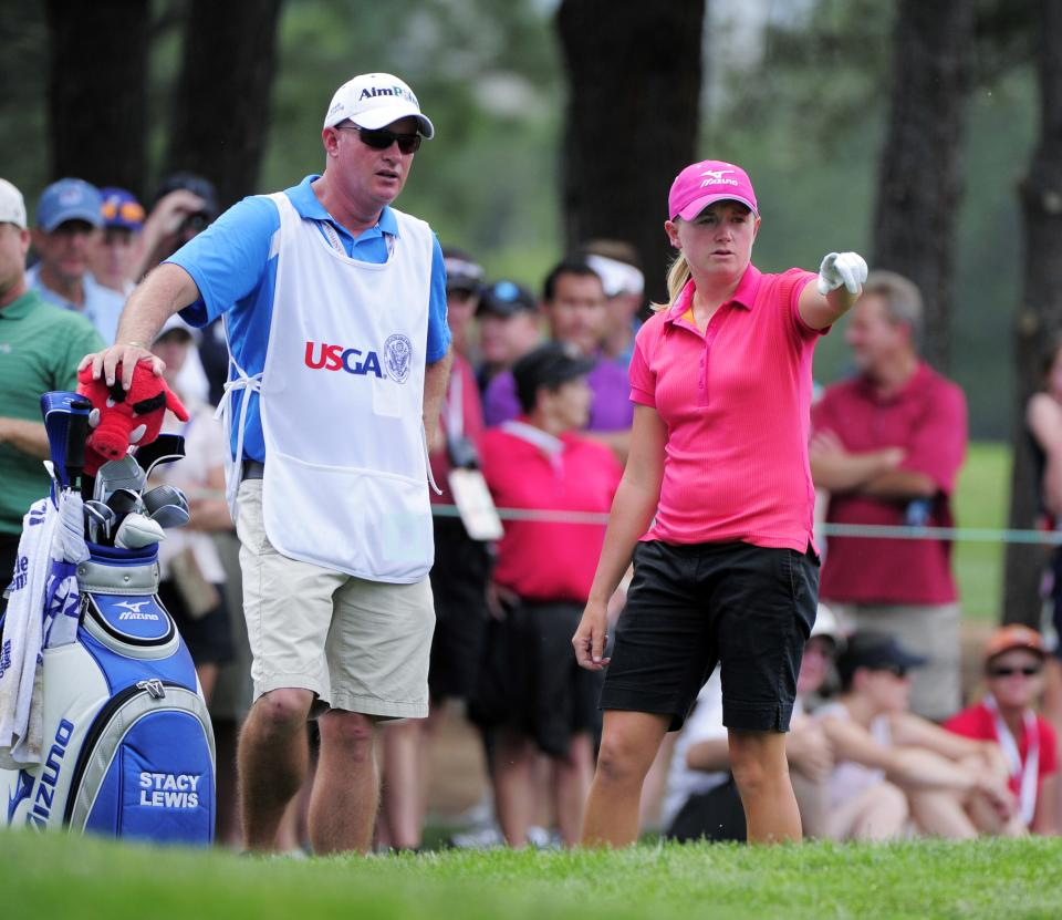 Stacy Lewis points to the second hole as she talks to her caddy Travis Wilson during the second round of the Women's U.S. Open golf tournament at the Broadmoor Golf Club on Friday, July 8, 2011, in Colorado Springs, Colo. (AP Photo/Mark J. Terrill)