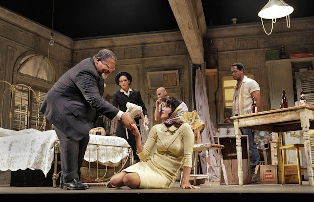 "In this April 2, 2012 photo provided by Springer Associates, from left, a doctor, played by Count Stovall, helps Blanche, played by Nicole Ari Parker, to her feet in a scene from ""A Streetcar Named Desire"" at the Broadhurst Theatre in New York. A talented multi-racial cast tackles Tennessee Williams' Pulitzer Prize-winning play about the clash between an aging and delusional Southern belle and her brutish brother-in-law. It opens Sunday, April 22, 2012. (AP Photo/Springer Associates, Ken Howard)"