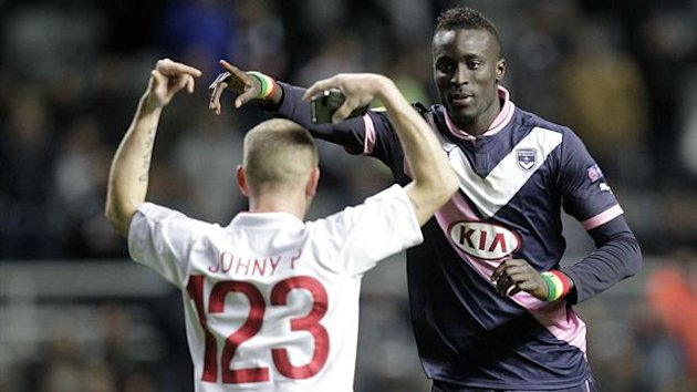 Bordeaux's Ludovic Sanz (R) confronts a streaker during a UEFA Europa League group D, football match against Newcastle United