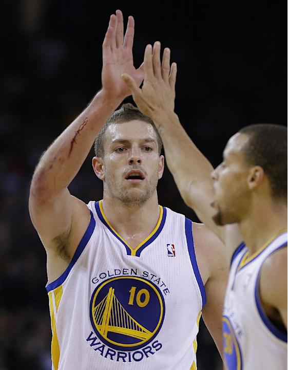 Golden State Warriors' David Lee (10) celebrates with Stephen Curry during the second half of an NBA basketball game against the Dallas Mavericks Wednesday, Dec. 11, 2013, in Oakland, Calif