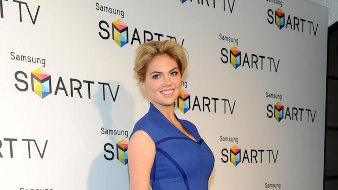 IMAGE DISTRIBUTED FOR SAMSUNG - Model Kate Upton helps Samsung showcase its 2013 line of Smart TVs, Wednesday, March 20, 2013, in New York. Samsung?s new line allows the viewer to discover more of the TV they love with a smarter and more personalized experience.  (Photo by Diane Bondareff/Invision for Samsung/AP Images)
