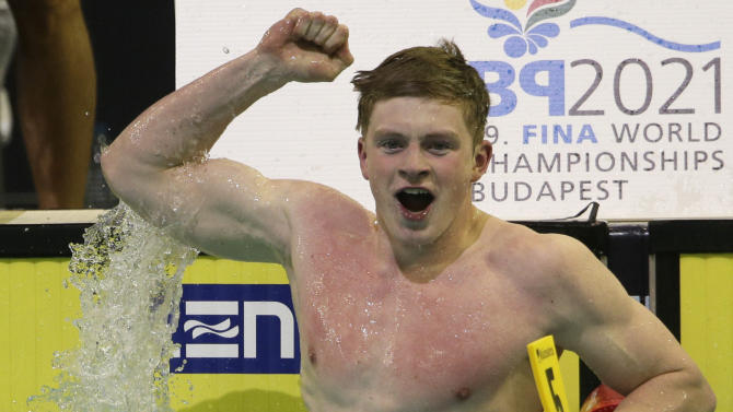 CORRECTS TO SEMIFINAL - Britain's Adam Peaty celebrates setting a new world record as he wins his men's 50m breaststroke senifinal at the LEN Swimming European Championships in Berlin, Germany, Friday, Aug. 22, 2014. (AP Photo/Gero Breloer)