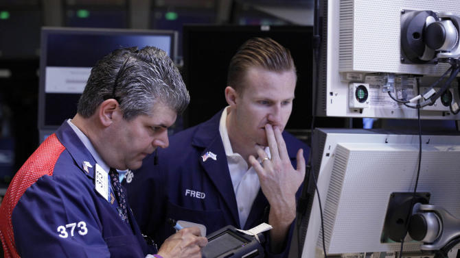 Trader John Panin, left, and specialist Frederick Edwards work on the floor of the New York Stock Exchange Friday, June 1, 2012. Stocks fell sharply Friday after the release of a dismal report on job creation in the United States. The Dow Jones industrial average dropped more than 200 points, erasing what was left of its gain for the year.  (AP Photo/Richard Drew)