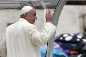 Pope Francis waves as he leaves after leading his weekly general audience at St. Peter's Square at the Vatican