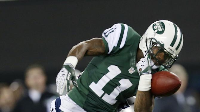 New York Jets wide receiver Jeremy Kerley (11) fumbles the ball as he is hit by New England Patriots' Steve Gregory (28) during the second half of an NFL football game on Thursday, Nov. 22, 2012, in East Rutherford, N.J. (AP Photo/Julio Cortez)